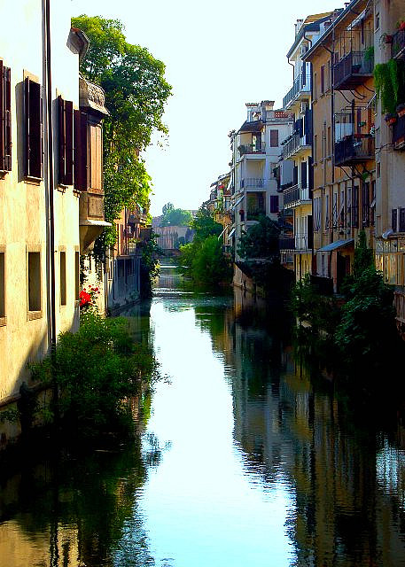 Padua. Into it. I once went to Bologna, which has canals, but they are COVERED BY STREETS. So I didn't see any canals. I would like to go to a city with canals. (That isn't in Florida.)